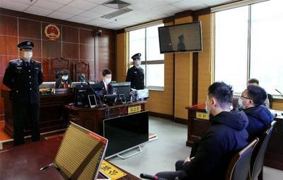 黄岛法院公开审理一起组织考试作弊案,两被告人均获刑一年半