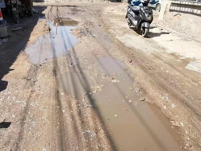 记者在现场│盐滩村道路泥泞难行,数百户居民期盼尽快修整